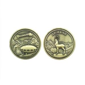 Монета металл Домбай бронза